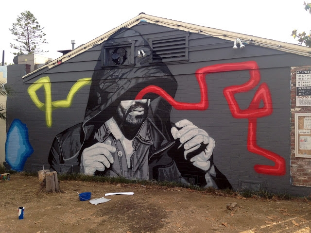 Devin Liston paints a new mural in Carlsbad