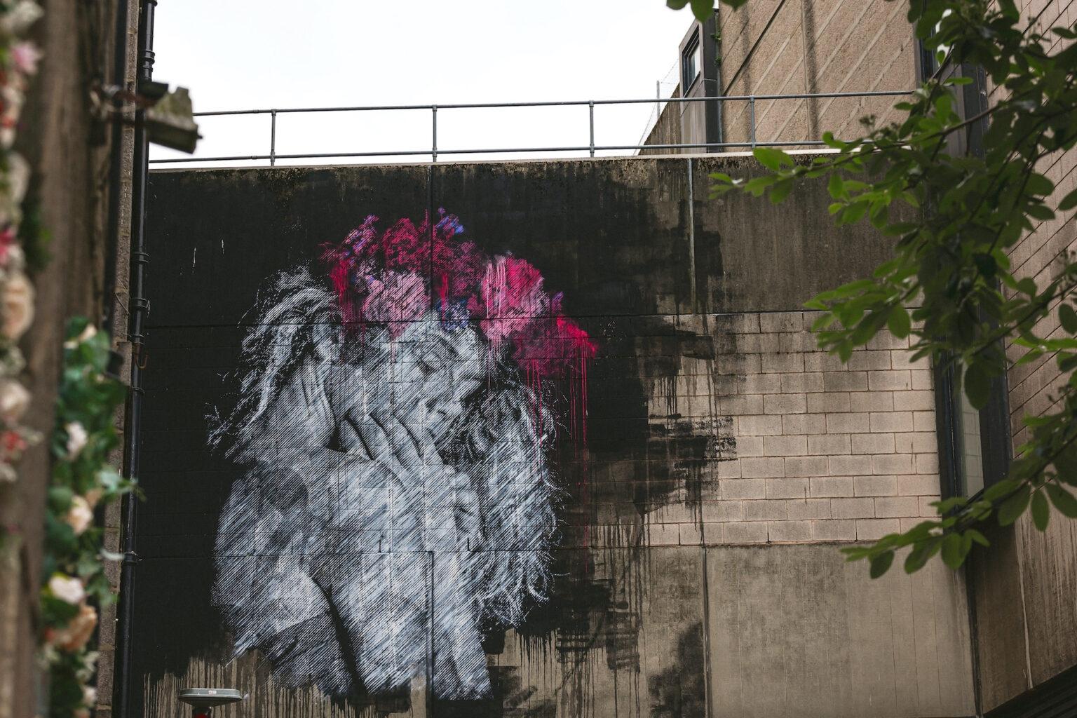 Mural by SNIK in Aberdeen, Scotland